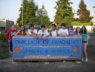 OLG Sign and Students.JPG.jpeg
