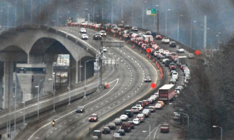 Traffic backs up eastbound on the West Seattle Bridge in this 2012 photo. Metro service cuts could make the situation even worse.